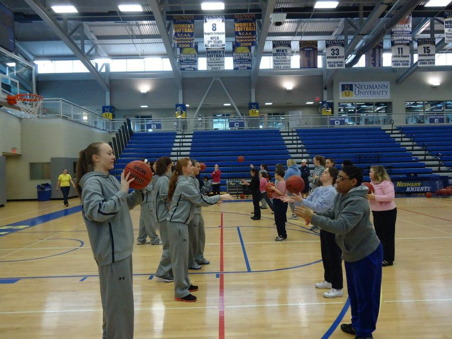 Learning how to play basketball at Neumann University
